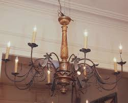 image of large wood and iron chandeliers