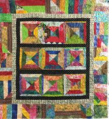 Home | Singing Stitches | Blog & The quilt below uses both a solid inner border and a pieced outer border.  The larger pieced border gives even more character to this bright, scrappy  quilt. Adamdwight.com