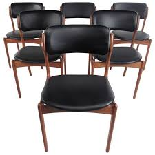 set of mid century eric buck dining chairs vine danish teak from a modern dining room