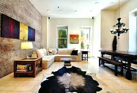 cowhide on wall cowhide rug on wall artwork on exposed brick wall and glass waterfall coffee