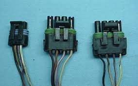electrical pg a est connectors that send the ignition signal back to the ecm the one of the left is for the small cap hei the center one is for the common large cap