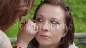 make up artist applies smoky eyes makeup on s face before photoshoot stock fooe video of attractive brunette 101575804