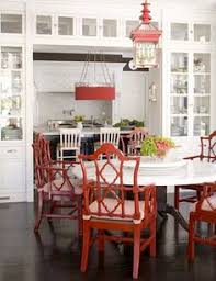a clic white kitchen gets an asian touch with lacquered red oriental design chairs and a hanging lantern via chinoiserie chic red and chinoiserie