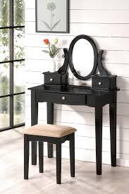 narrow black makeup vanity table set with 3 drawers and oval spinning mirror plus cushioned backless