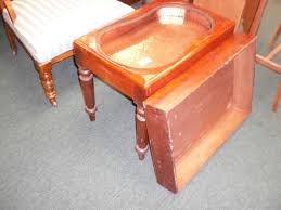 beautiful and unique kidney shaped hammered copper baby s bathtub in a fitted wooden stand with beautiful turned legs