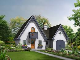 fairy tale like cottage with steep gabled roof and window boxes