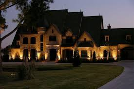 lighting dallas tx exterior of large two story house at night