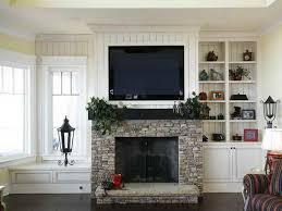 Small Picture Wall Mounted Fireplace with TV Above tv over fireplace ideas