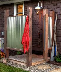 here is an example of a simple outdoor shower with a rustic mediterranean feel