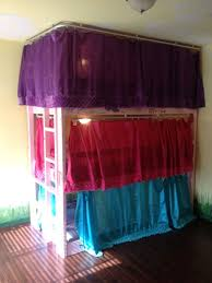 homemade triple bunk beds for a standard 9 ft ceiling also made curtains for each bed