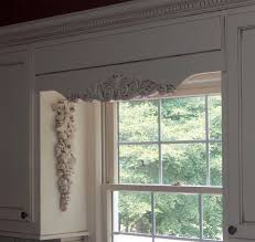 interior carved decorative wooden window valances with white cabinet and sliding window get the