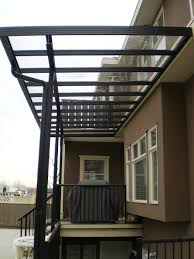 aluminium patio cover surrey: glass patio covers allow light into the patio area without the rain its an excellent way to get more use out of your outdoor space
