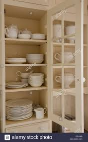 Open Kitchen Cupboard Assorted White China In An Open Kitchen Cupboard Stock Photo