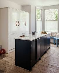 dark hued beadboard cabinetry in in the kitchen with skye gyngell london s chef du