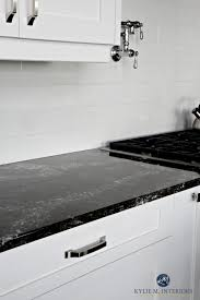 cambria ellesmere black quartz countertop white kitchen cabinets and off white light gray subway