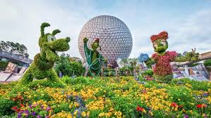 disney flower and garden. Topiaries Of Mickey, Minnie, Goofy And Pluto Displayed Directly In Front Spaceship Earth Disney Flower Garden A
