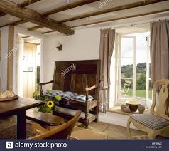 Country cottage dining room Design Ideas Country Cottage Dining Room With Wood Beamed Ceiling Settee Bench Seat Dining Table And Chairs And An Open Window Alamy Country Cottage Dining Room With Wood Beamed Ceiling Settee Bench