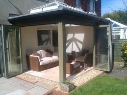 brown stained wooden frame folding patio door with glass panel combined