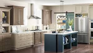 kitchen with tan cabinets and blue island