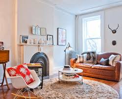 round rugs in the living room if your living space is like most it s probably filled with rectangular shapes and sharp edges a round rug can help soften