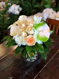 creamsicle delight a creamy pastel mix featuring hydrangeas roses phalaenopsis orchid blooms and