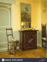 decorative wood side unit traditional dining room yellow pale blue green walls dado rail interiors rooms