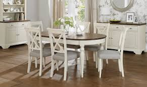 oval dining table set for 6 with wooden counter top table and white dining chairs with grey pads