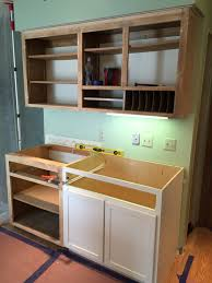 during new cabinets are installed to make the area more functional with storage rather than the unused desk