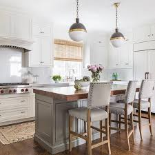 Thick Butcher Block Island Countertop with Gray Nailhead Counter Stools,  Transitional, Kitchen Im not a fan of the lights, but the rest is beautiful