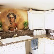 small kitchen design ideas. small kitchen with white cabinetry granite worktop ceramic sink and statement artwork design ideas