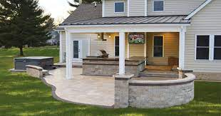 covered outdoor kitchen with tv and