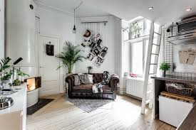 A cool tiny studio apartment with Chesterfield sofa and loft bed ...