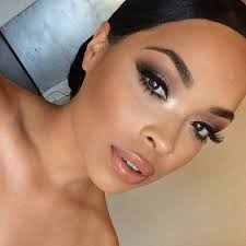 bridal makeup for brown skin with a peachy c lip false lashes on top and bottom with a slightly smokey eye