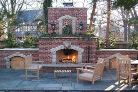 formal brick outdoor fireplace blue stone pavers