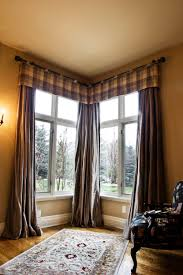 Corner windows with masculine window treatment.
