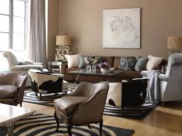 cowhide and zebra print rug as animal print decorating ideas plus driftwood lamp on side table