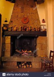 Kitchen Fireplace For Cooking Open Hearth Cooking Fire In Restaurant In The Etruscan Hilltown Of