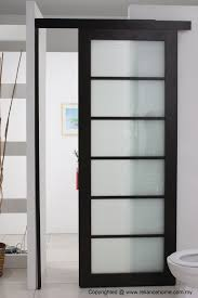 nice looking frosted sliding single bathroom doors for minimalist bathroom decors in white painted wall interior