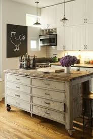 Salvaged Store Counters Used As Kitchen Islands Via Heir And