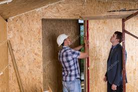 architect and worker checking levels on