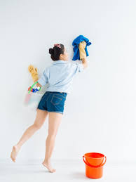 cleaning walls paints wiping a wall