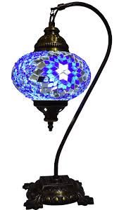 made from mosaic pieces of coloured glass not painted which covers a glass bulb with metal decorative handmade wired lamp with fitted three pin uk plug