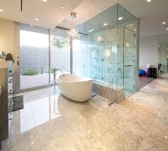 mid century modern bathroom tile dark brown stained vanity cabinet floor to ceiling window black finish
