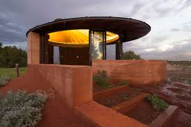 the design was later adjusted to include sliding glass windows to protect it from the sand storms the area is known for the glazings are curved to