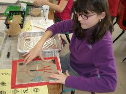 navajo sand painting at fisher school two artists from the south s art center in cohasset recently came to fisher school to work with mrs hirschfeld s