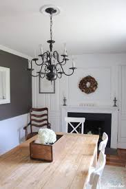 an easy chandelier makeover with spray paint in our farmhouse dining room