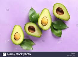 Avocado Light Halves Of Ripe Avocados On Light Background Stock Photo