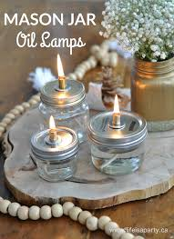 diy mason jar oil lamps simple to make and so beautiful perfect for a party wedding centerpiece or just in your home