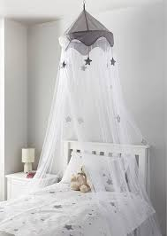 B&M is selling a child's bed canopy decorated in silver stars for ...