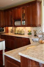 Kitchens With Cherry Cabinets Awesome Cherry Kitchen Cabinets With Gray Wall And Quartz Countertops Ideas